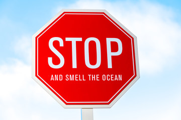 """Stop and smell the Ocean"" traffic sign in southern California"