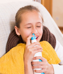 Sick child with nasal spray