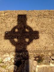 celtic cross gravestone shadow