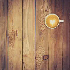 Latte coffee on wood background and texture with space
