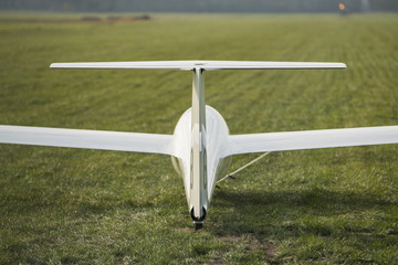 Pull up a white glider on an airstrip in Netherlands
