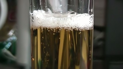 Pouring light beer into glass.