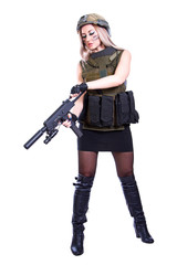 Woman in a military camouflage reloading the smg