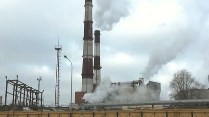 industry. Plant and smoking factory chimneys