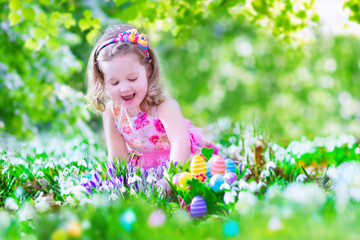 Adoraable little girl at egg hunt