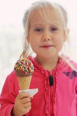 portrait of beautiful happy girl eating ice cream