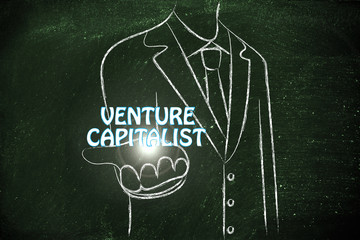 business man handing out the word Venture Capiltalist