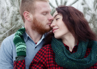 outdoor fashion portrait of young sensual couple love and kiss