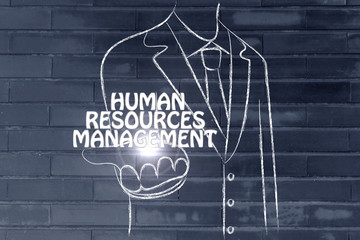 business man handing out the word Human Resources Management