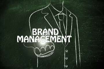 business man handing out the word Brand Management