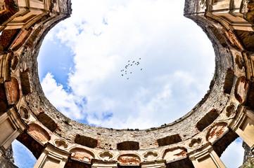 Krzyztopor - impressive castle ruins and flock of birds, Poland