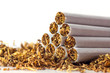 Leinwandbild Motiv cigarettes in loose tobacco, close up against white
