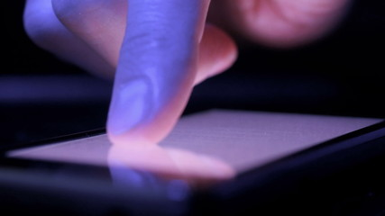 Finger touching tablet computer touchscreen. 4K UHD footage