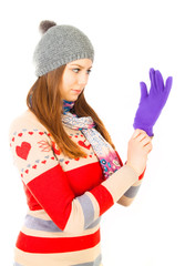 Young girl wear winter gloves on white background