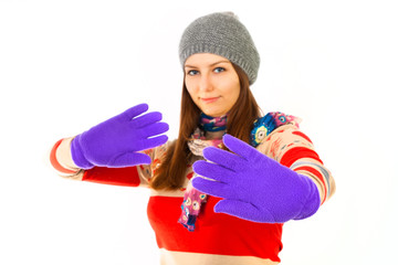 Portrait of surprised, happy girl in winter gloves on white back