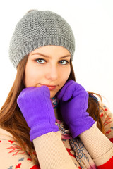 Closeup portrait of good girl emotion in winter gloves on white