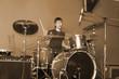 man playing on drum