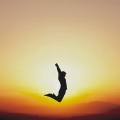 dancer jumping in sunset