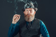 Adult Man with Long Beard Smoking a Cigarette - 79764236