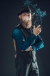 Stylish Guy with Goatee Posing with a Cigarette - 79764243