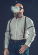 Stylish Bald Goatee Man Smoking a Cigarette - 79764264