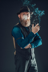 Stylish Guy with Goatee Posing with a Cigarette