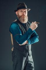 Stylish Man with Long Beard Holding a Cigarette