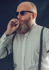 Close up Bald Goatee Man Smoking a Cigarette
