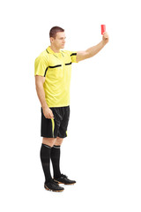 Football referee showing a red card