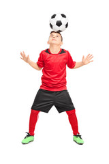 Junior soccer player joggling with a ball