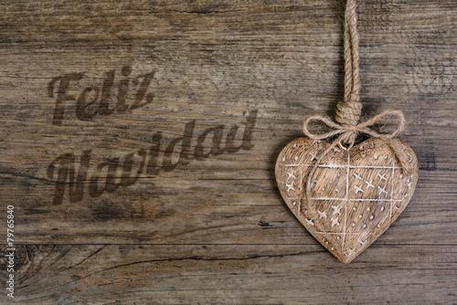 Wooden heart on vintage oak background and caption