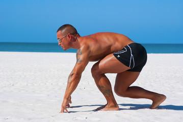 Lean muscular man ready to race