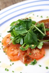 plated tomato and watersress salad