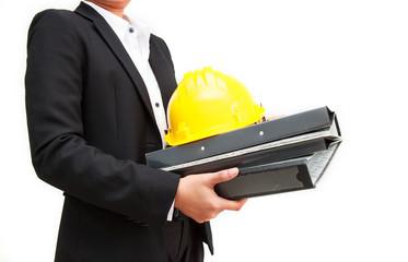 International business concept. engineer holding helmet and docu