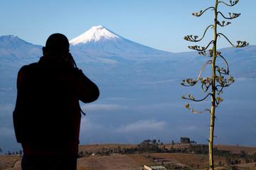 Tourist observing majestic Cotopaxi volcano in Ecuador