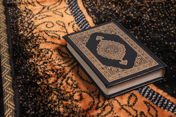 Quran on the prayer rug