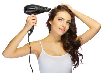 Young girl with hair dryer