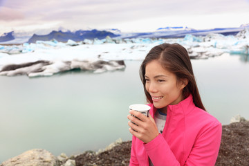 Woman drinking coffee on travel trip on Iceland