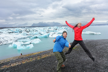 Travel people couple having fun jumping on Iceland