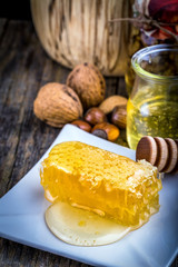honey dipper and honeycomb, nuts of various kinds
