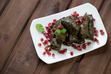 Grape leaves stuffed with rice and meat, high angle view