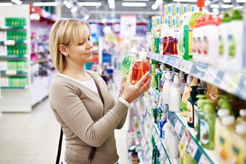 Woman chooses fragrant liquid soap in store