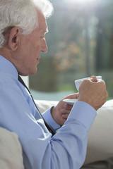 Senior businessman drinking coffee
