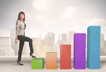 Business person climbing up on colourful chart pillars concept