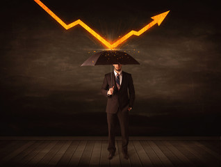 Businessman standing with umbrella keeping orange arrow