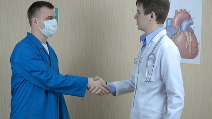 two doctors men shake hands