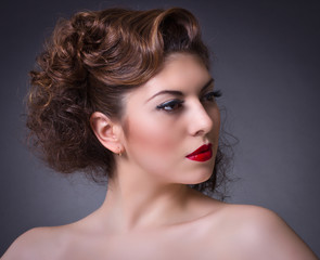 Portrait of beautiful sensual woman with elegant hairstyle.