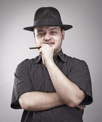 Handsome man with hat and cigar.
