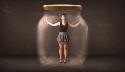 Businesswoman captured in a glass jar concept