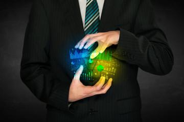 Businessman holding diagram cloud